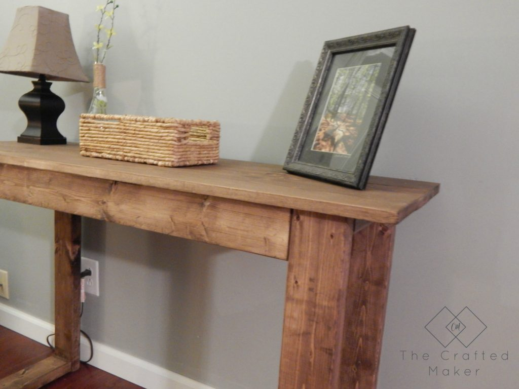 Come check out how to build this $25 console table with very little supplies needed. Free PDF plans included along with a step by step build with pictures.