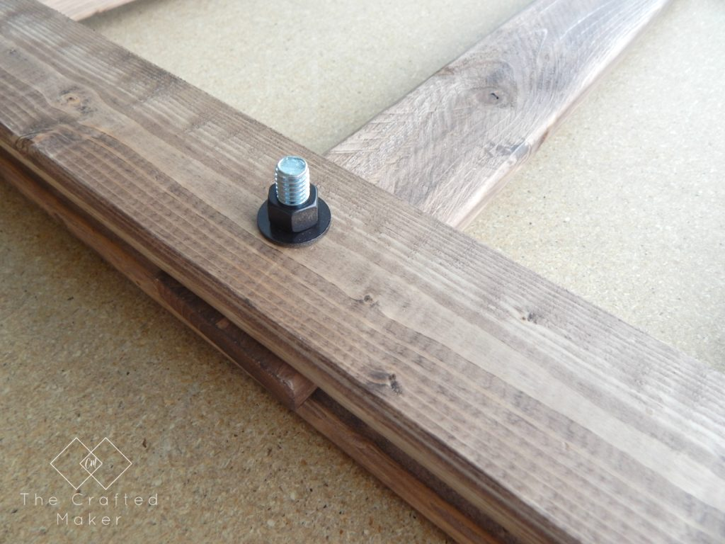 Build this DIY Arhaus inspired end table! Easy build with just a few sizes of wood and nuts and bolts. Great weekend project. Includes free PDF plans!