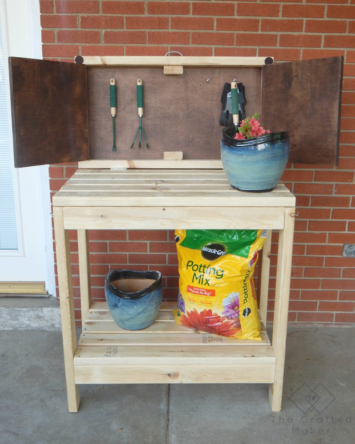 Transform your garden party to a gardening party with this DIY Party Cart / Potting Bench.Lift up to find hidden storage for all of your garden tools.