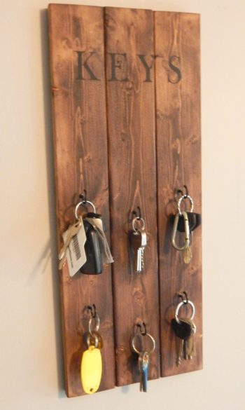 Learn how to make this very quick and easy DIY hanging key holder. Stop all of the key clutter around your house and add a little décor at the same time.