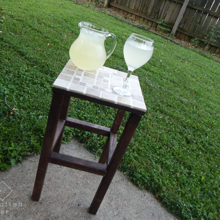 Add some decor to your outdoor party area. This DIY tiled end table with FREE PLANS is the perfect project to ring in the summer barbeque season.