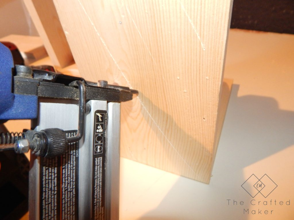 Nailing the Brackets from the back for the DIY Wood Bookends - The Crafted Maker