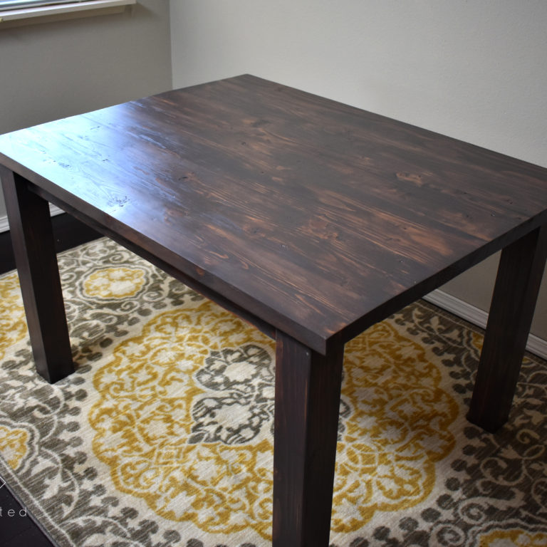 Build this modern farmhouse dining table for your next gathering. This table is perfect for smaller dining rooms or breakfast nooks.