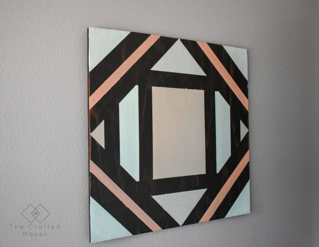 Make this fun geometric scrap wood wall art with scrap wood and paint you already have on hand. This is a quick, colorful, and creative afternoon project!