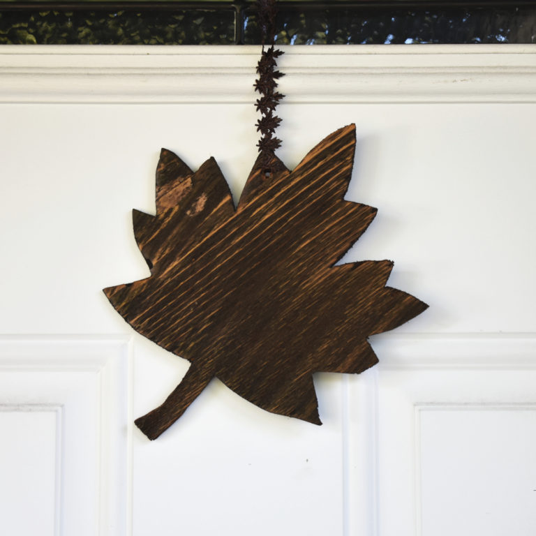 Fall is finally here and it's time to decorate accordingly. Make this quick, easy, and adorable Fall leaf door hanger with scrap wood you already have!