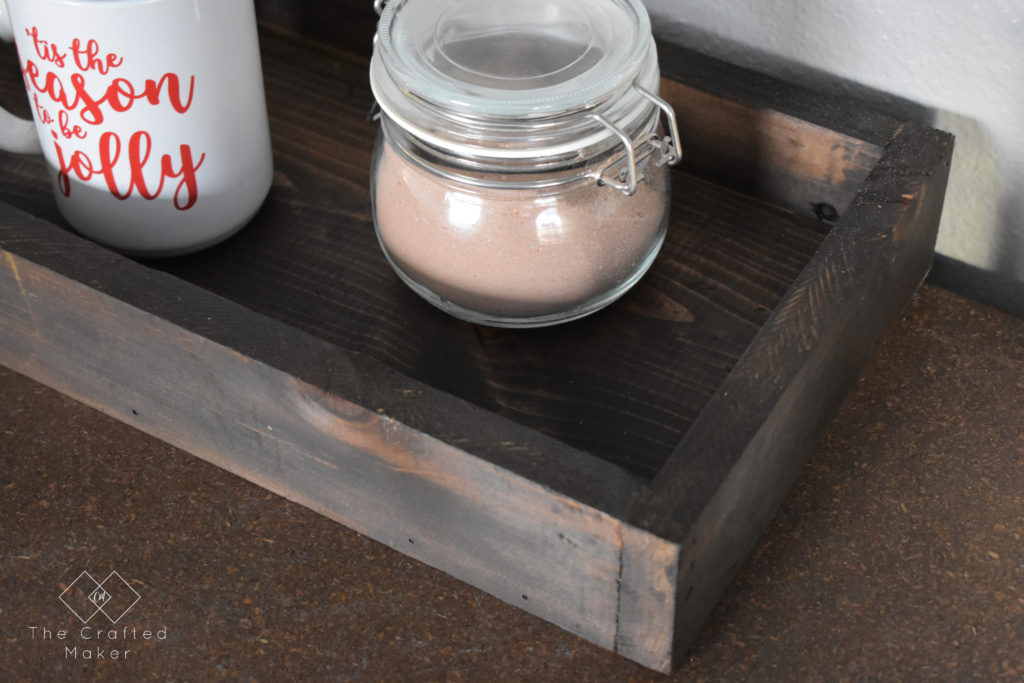 A wooden tray is a staple in home decor. It not only looks good mixed in with decor but serves a purpose too! Build this simple wooden try in about an hour.